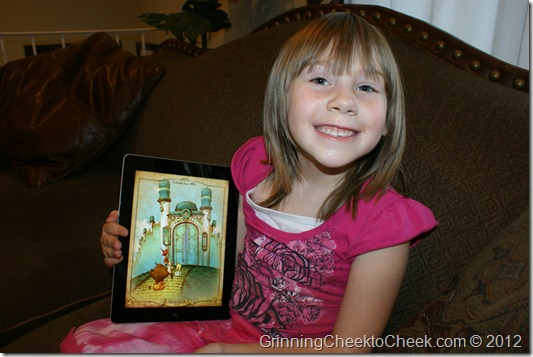 girl with storybook on tablet