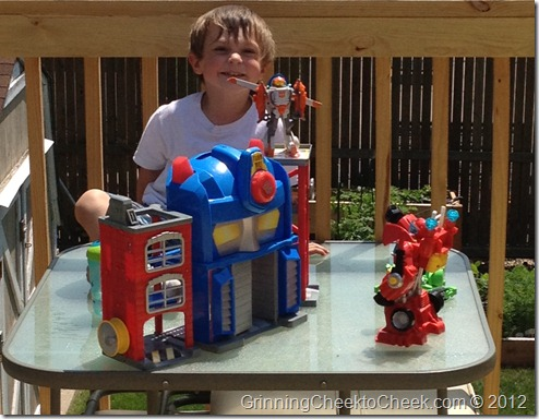 boy with Optimus Prime fire station