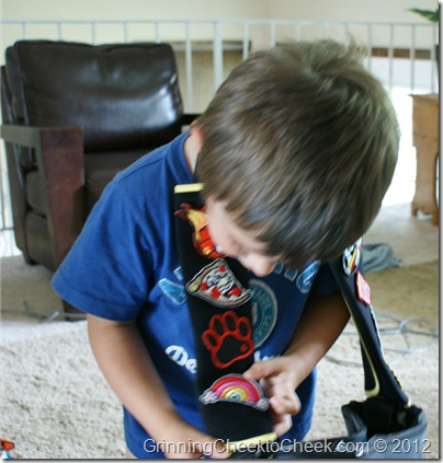 Gutzy Gear, boy examining patches