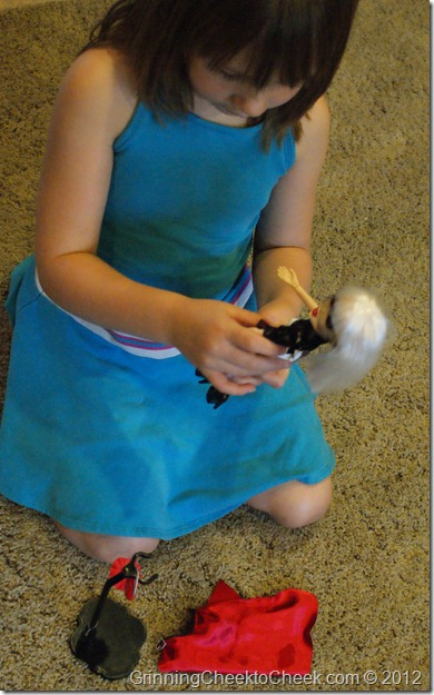Girl Playing with Good Witch Doll