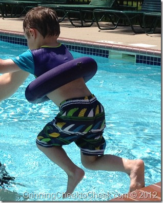 jumping into water with swim sweater