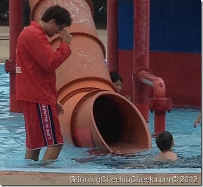 boy with coach at waterslide