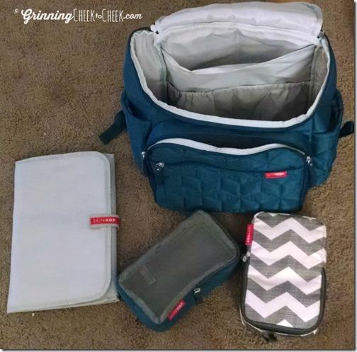 skip hop backpack diaper bag grinning cheek to cheek. Black Bedroom Furniture Sets. Home Design Ideas